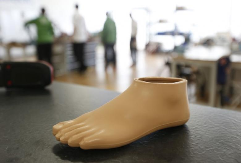 A prosthetic foot is seen on a work table in the Ottobock workshop at the Athlete's Village in the Olympic Park in Stratford, east London