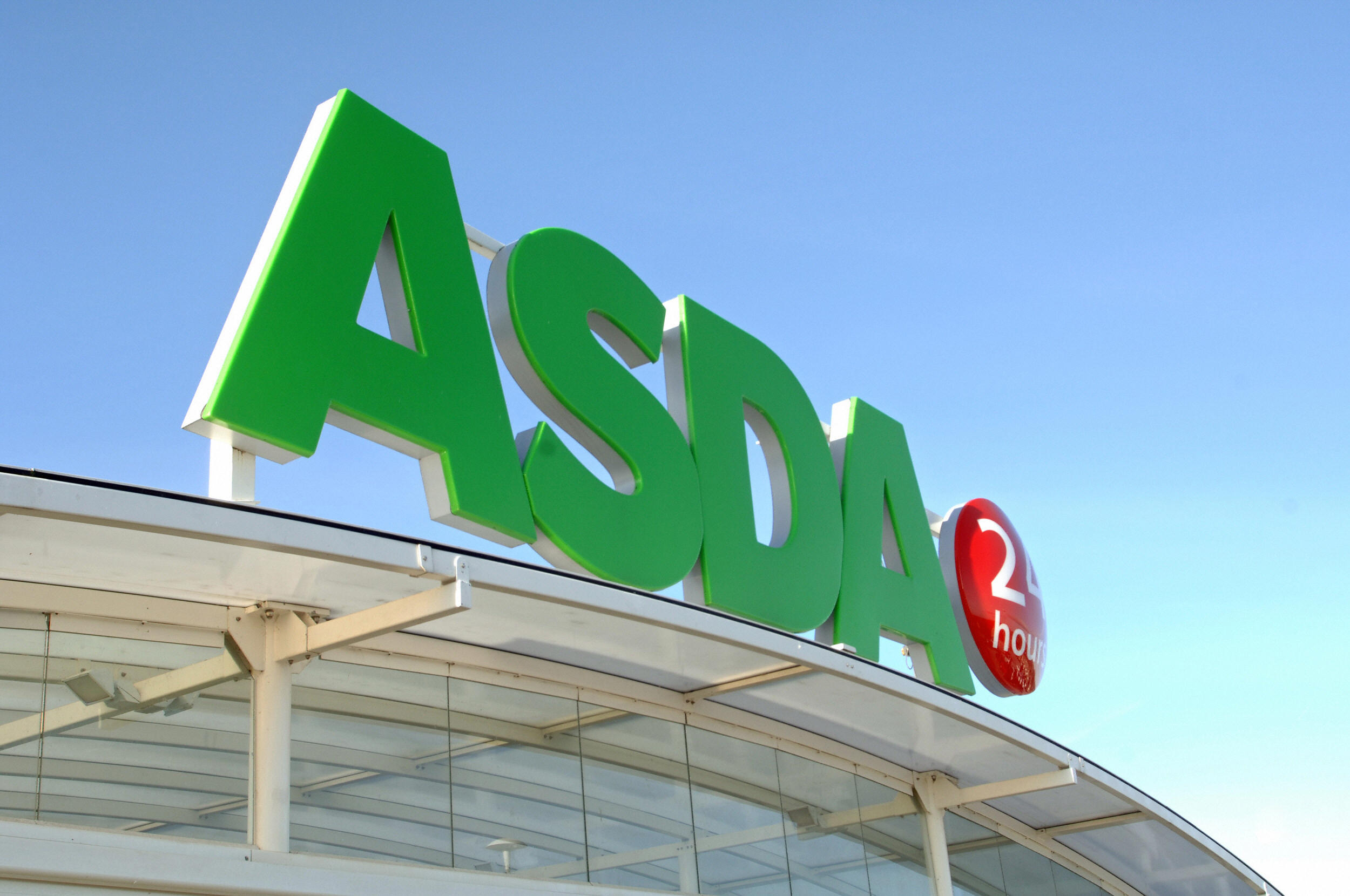 An Asda supermarket store logo is pictur