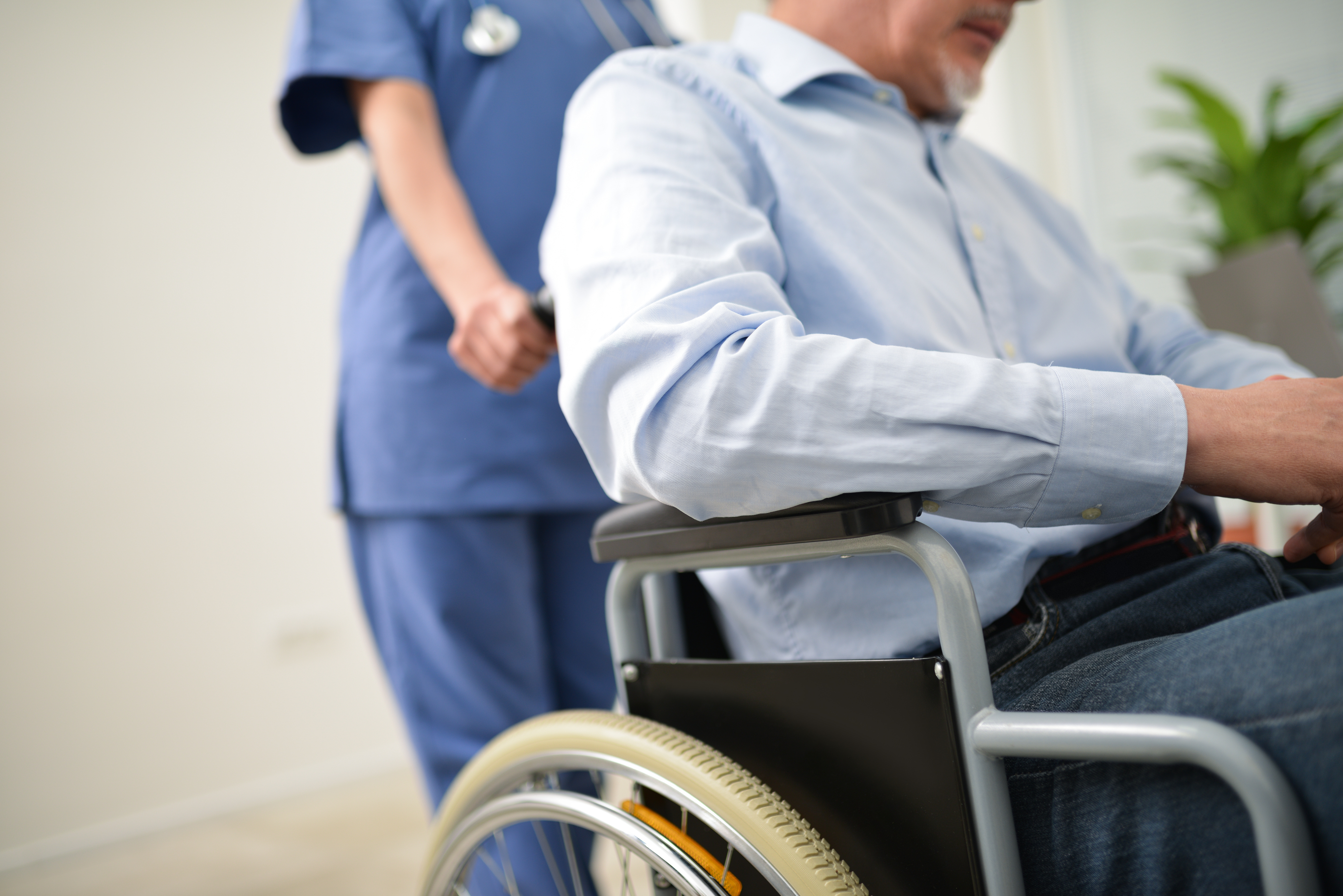 stock care home nurse wheelchair hospital