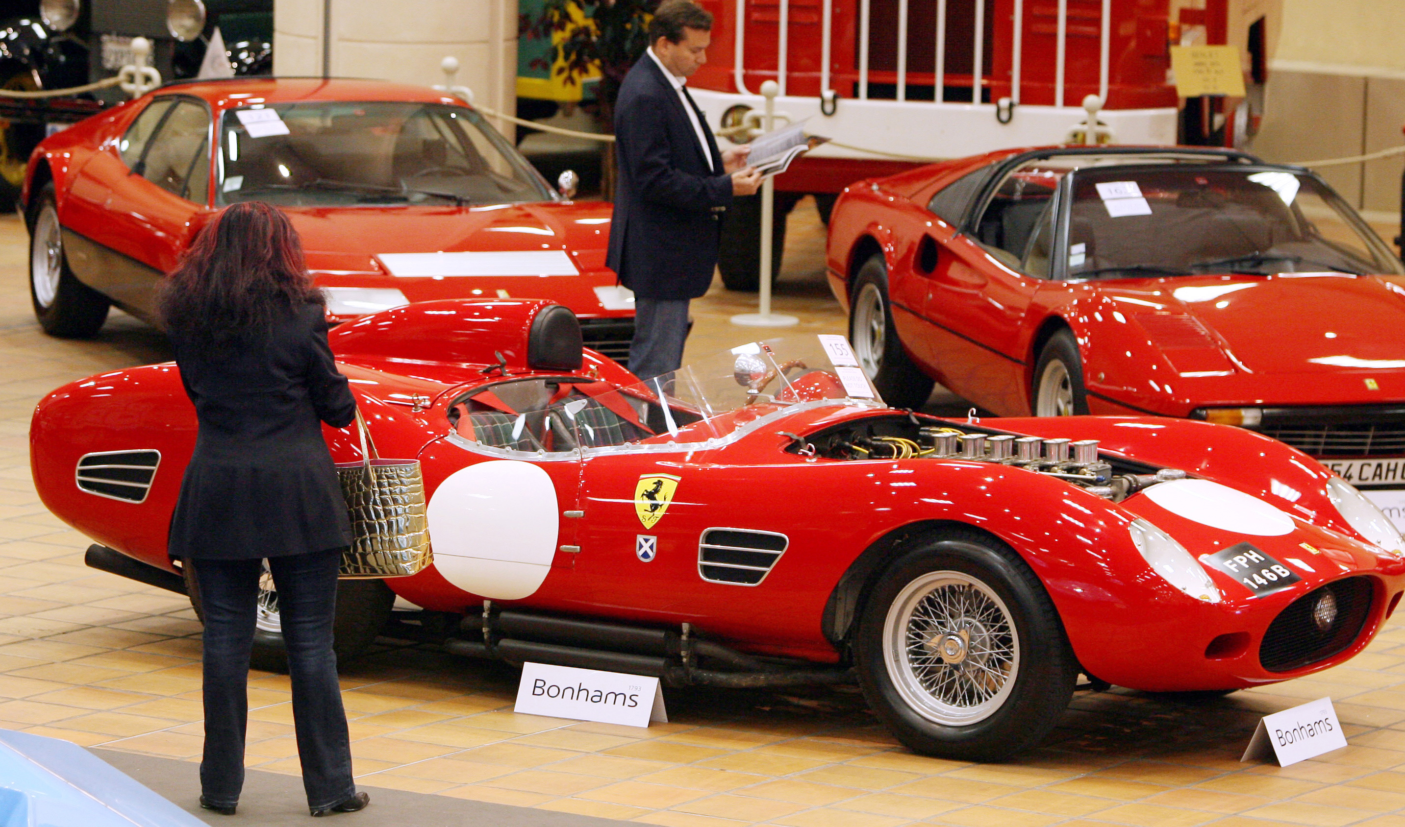 Visitors look at a 1964 Ferrari 250Tr pr