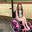 Amelia wearing sunglasses on her new wheelchair