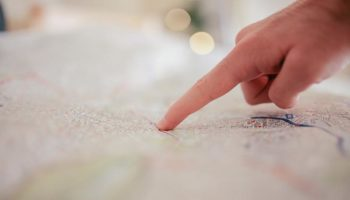 map-finger-spot-point-locate