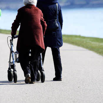 mobility-aid-walking-frame-equipment-stock-elderly-crop-shutterstock_1058068703