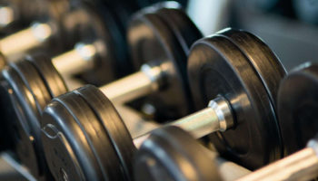 bodybuilding-dumbbells-gym-stock-crop260352