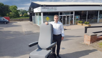 Yorkshire Care's MD Tristan Hulbert with the ProSpec Hospital Chair
